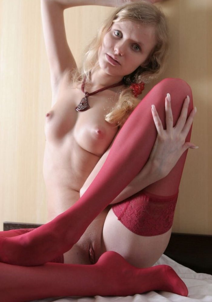 Teen blonde Irina L in red stockings
