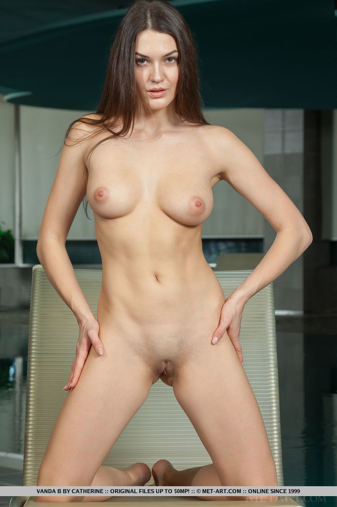 Vanda B	strips in front of the camera baring her delectable body.