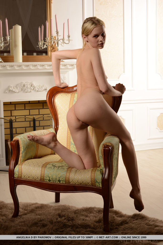 Angelika D strips her sexy lingerie baring her round, meaty ass and yummy pussy as she poses on the chair.