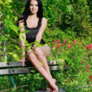 Beautiful Lola Marron playfully poses in the garden as she strips on the chair baring her delectable body.
