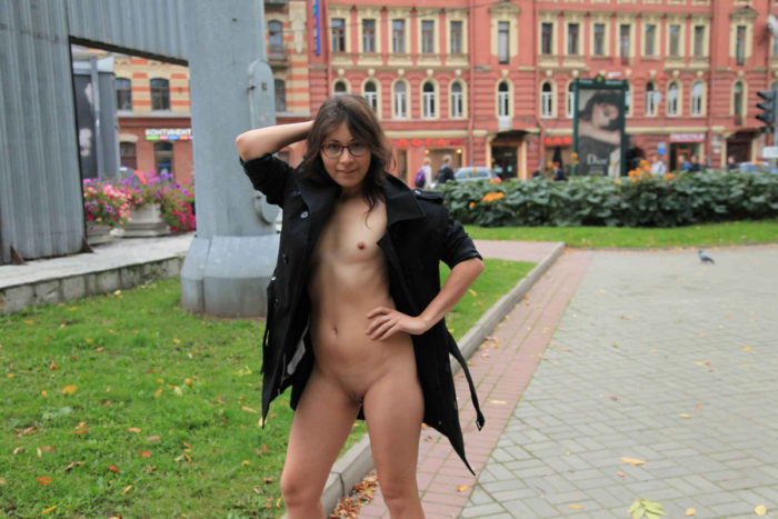 Exhibitionist girl Nataly flashes her small tits at city