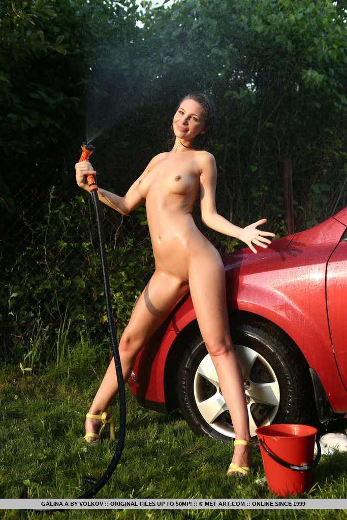 Galina A shows off her wet, sexy bod as she washes the car.