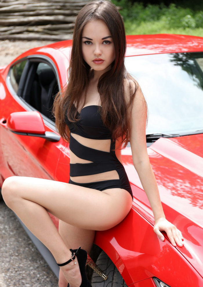 Hot brunette Li Moon and red Ford Mustang