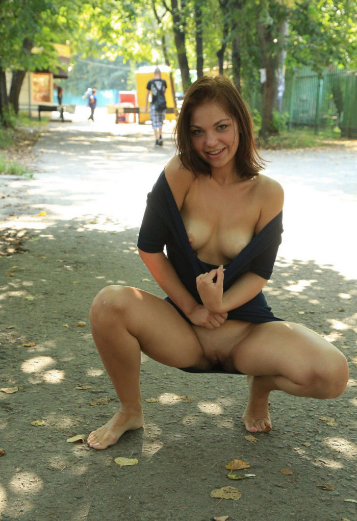 Joyful girl flashes her tits and pussy on public streets