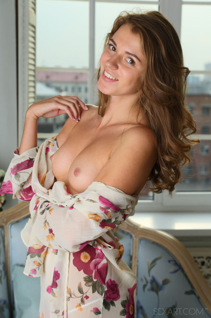 Kalisy takes off her floral robe and panty and starts touching herself