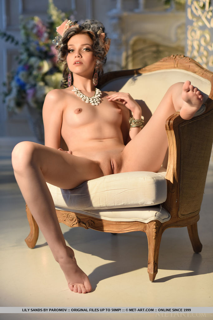 Lily Sands strips her elegant dress baring her delectable pussy.
