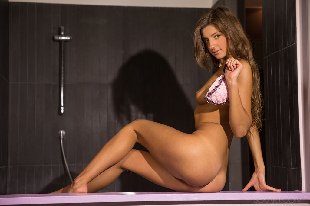 Melena A takes off her pink matching lingerie before soaking her perfectly tanned body in the jacuzzi