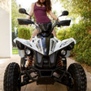 New model Alice May playfully poses on the ATV.
