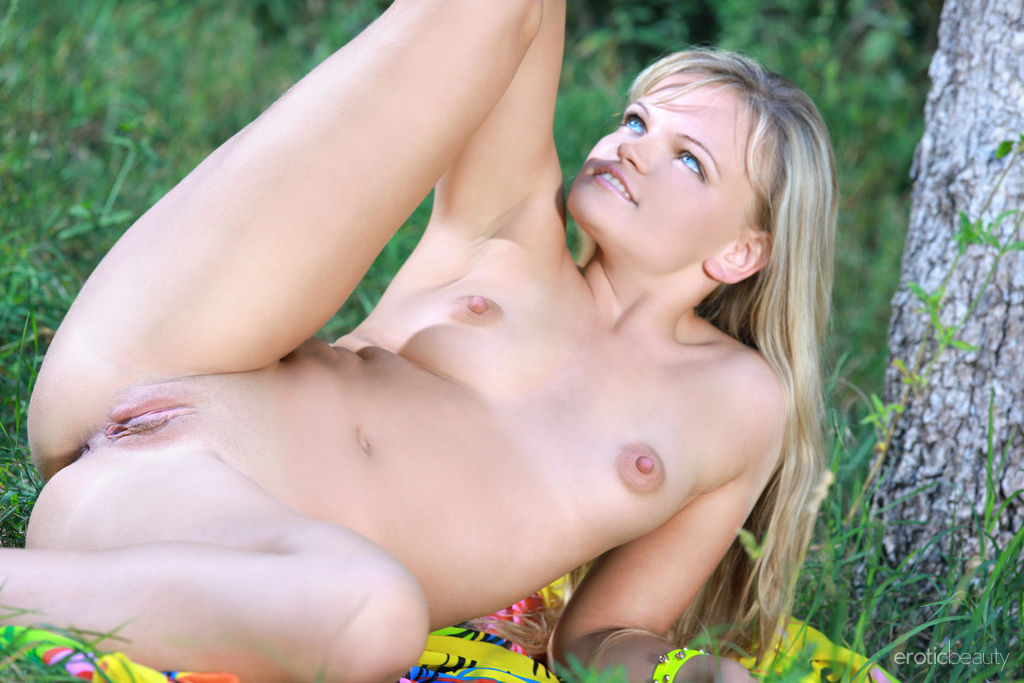 Newcomer Malinka A sensually poses on the grassy field.