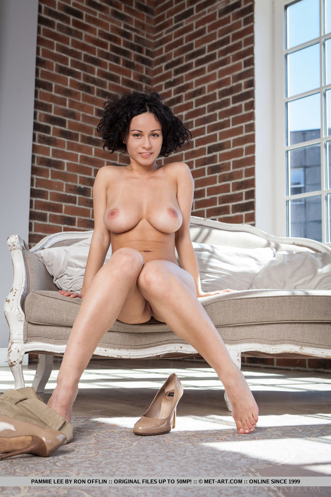 Pammie Lee displays her gorgeous tits and trimmed pussy on the chair.