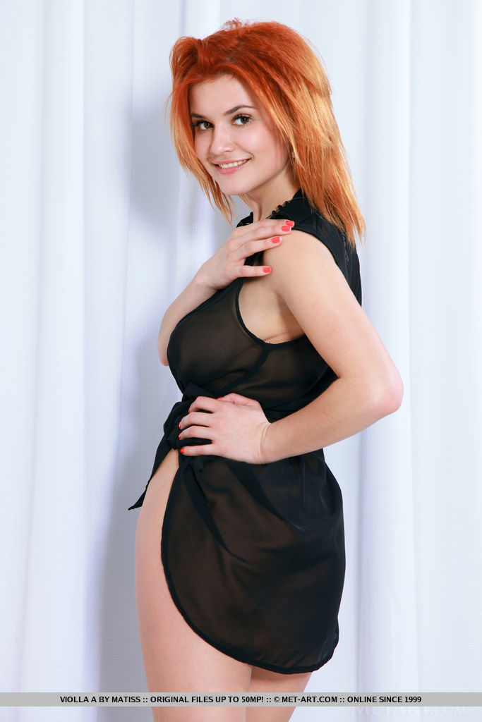 Redhead Violla A bares her luscious body on the chair.