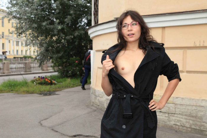 Russian girl Nataly in glasses poses at city center
