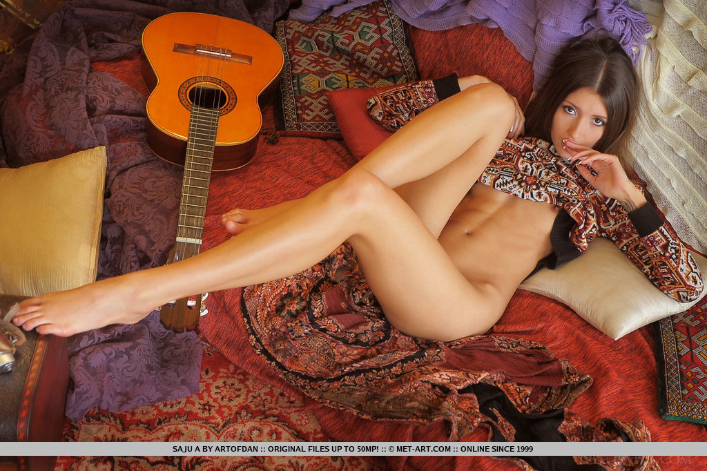 Saju A flaunts her sexy slender body and sweet pussy as she poses with a guitar.