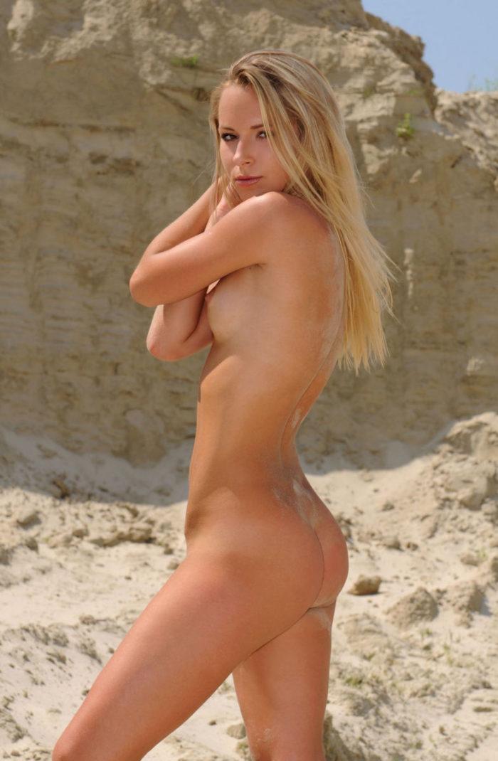 Slim blonde Olga Q at sand quarry