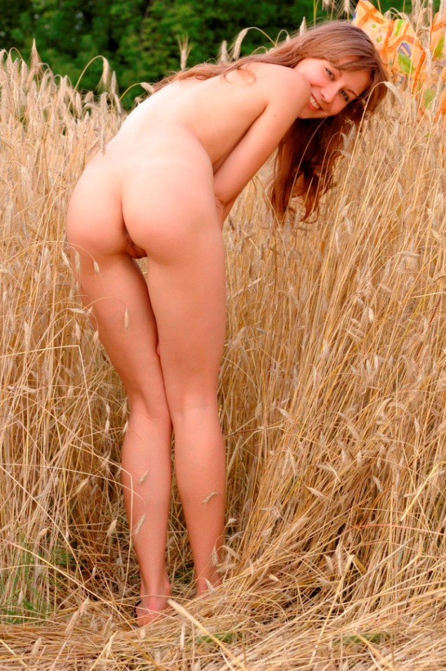 Smiling russian amateur removes panties in the field