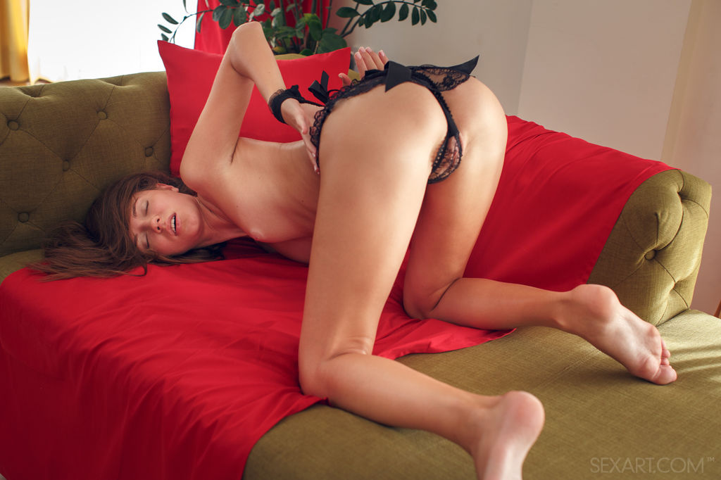 A playful and adventurous Kalisy posing with delicate black lace before masturbating infront of the camera