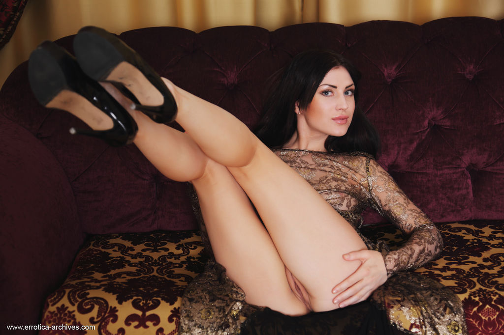 Alluring Sasha Bree spreads her legs wide on the sofa as she flaunts her   delectable pink pussy.