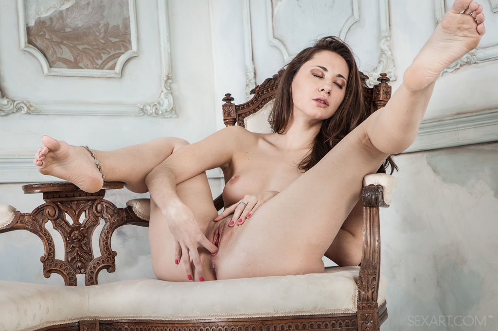 Assoli sensually takes off her lingerie before masturbating her wet pussy