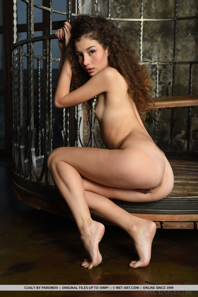 Cury-haired Cualy flaunts her petite body and sweet pussy on the swing.
