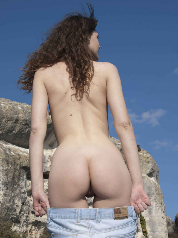 Girl Inessa A in jeans posing at white rocks