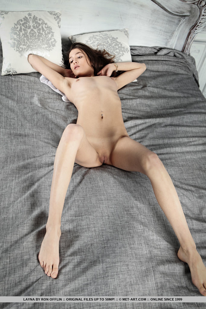 Gorgeous Layna strips her dress on the bed as she flaunts her slender sexy body,   long legs and yummy pussy.