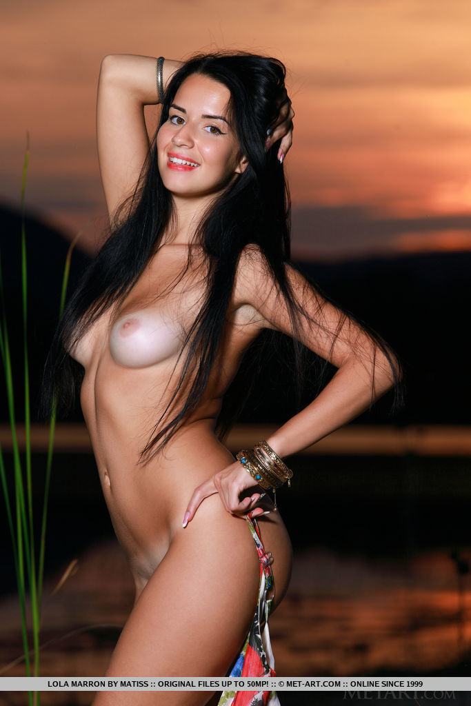 Lola Marron bares her sexy, tanned body as she poses outdoors.
