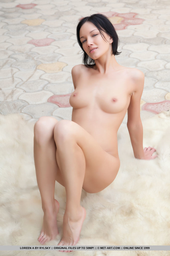 Loreen A shows off her gorgeous body with beautiful breasts and pink pussy as   she poses on the bed.