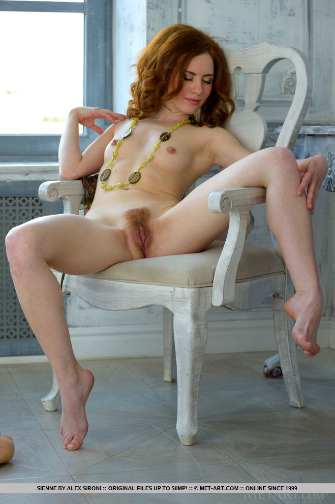 Lusty redhead Siene undressing her skimpy green dress, revealing her smooth, fair body, pink and puffy nipples, and exquisite, unshaved bush