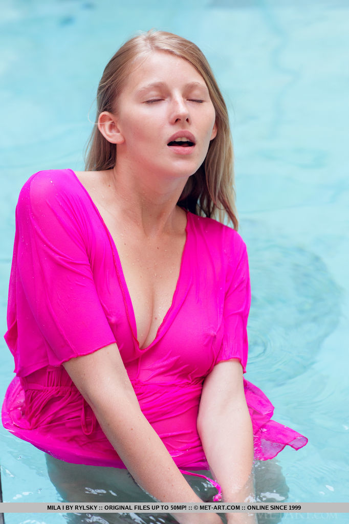 Mila I takes off her bright lavender robe and takes a skinny dip in the pool