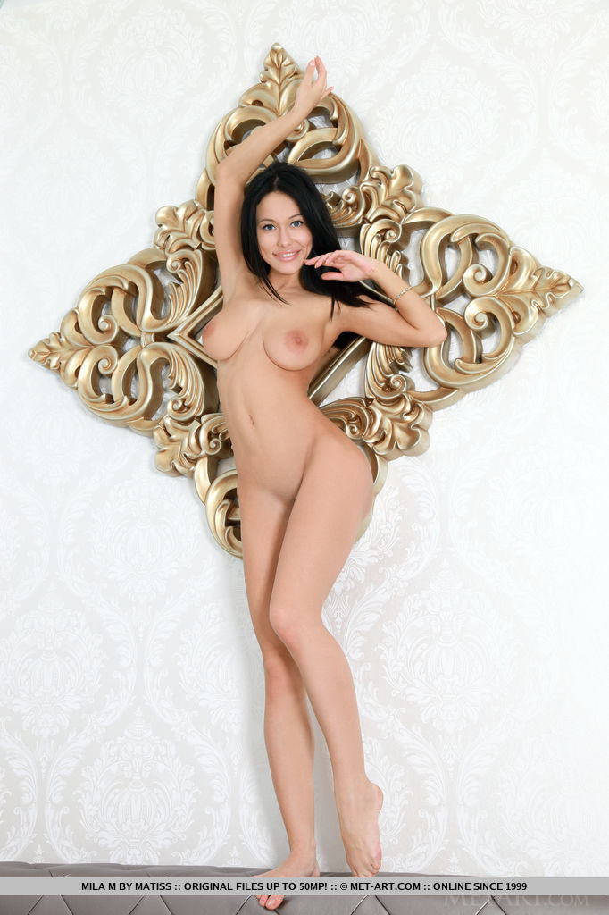 Mila M teases and seduces as she lounges on top of the sofa, showing off her exquisite assets