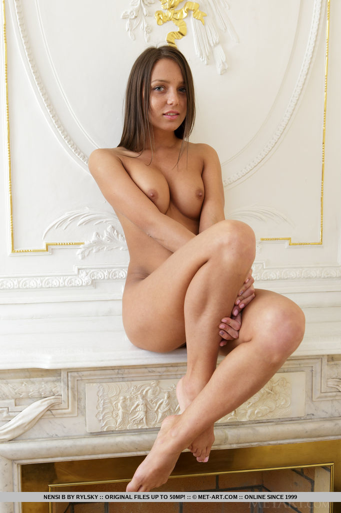 Nensi B poses naked for the camera, showing off her lean body with sunkissed complexion, puffy breasts, and round ass