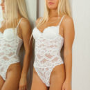 Pretty blonde Xena wearing her white lace teddy lingerie that shows off hr gorgeous curves