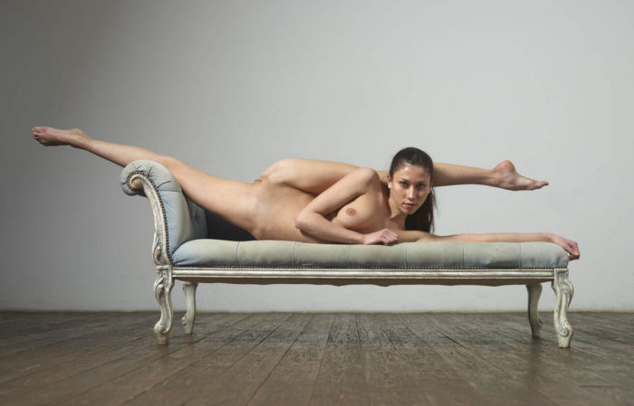 Russian naked gymnast girl widely spreads legs