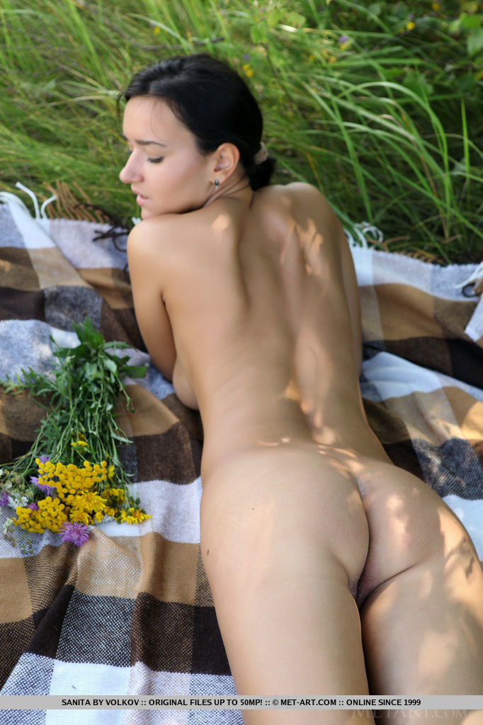 Sanita strips in the outdoors baring her luscious body with large breasts and plump pussy.