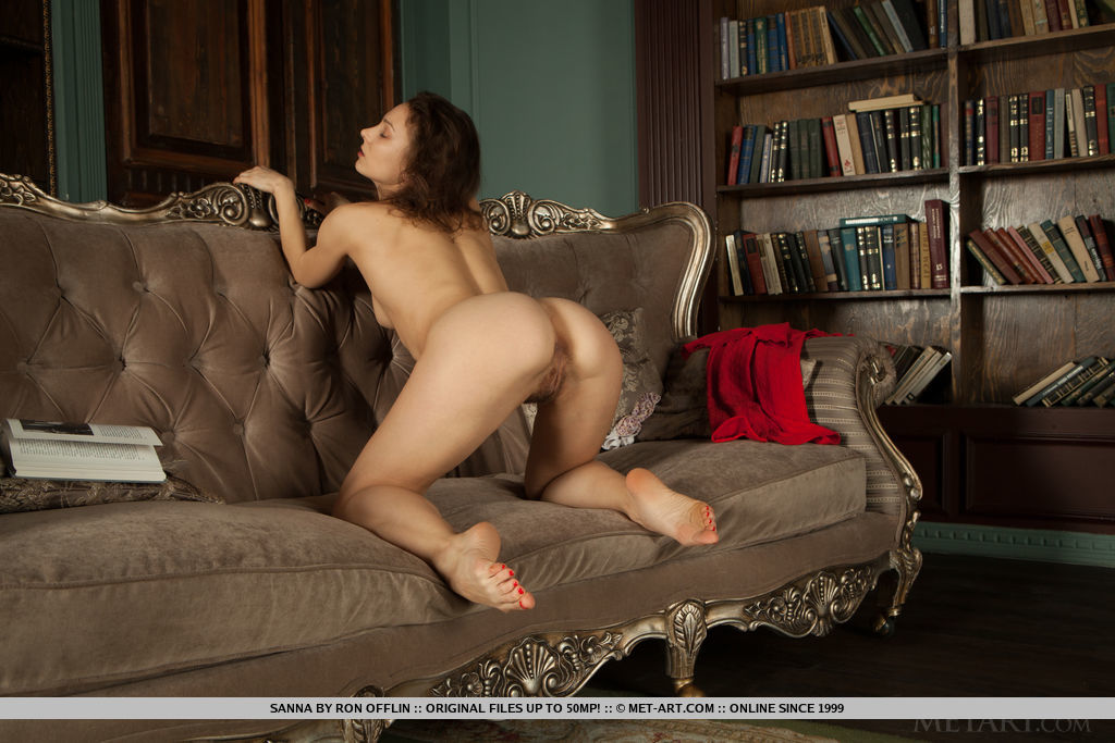 Sanna displays her unshaven pussy as sheposes on the sofa.