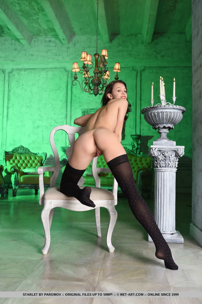 Starlet strips her sexy corset and lingerie baring her sexy body and yummy pussy as   she poses on the chair.