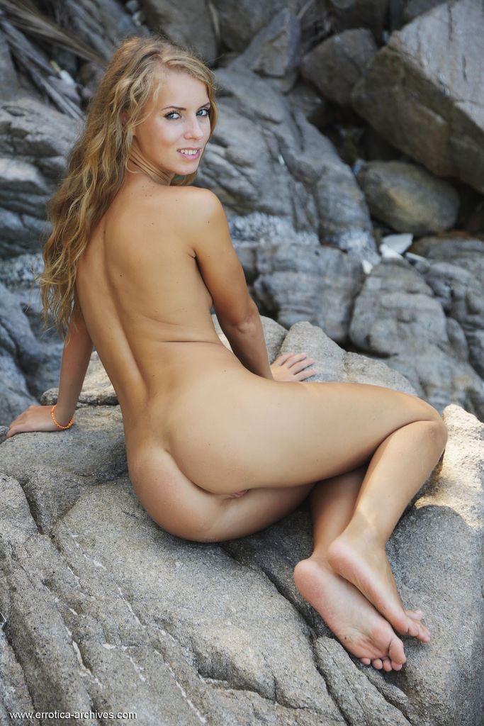 Stella Lane shows off her sweet pussy by the rocky beach.
