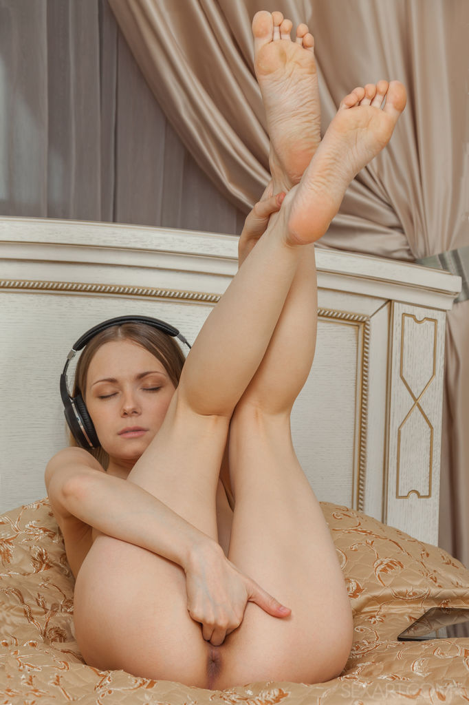 Sweet Lenore listens to some music before pleasing her pink, shaved pussy