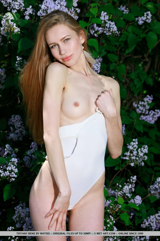 Tiffany Bene makes a spectacular view as she shows off her porcelain smooth body, fair skin, and pink assets in the garden