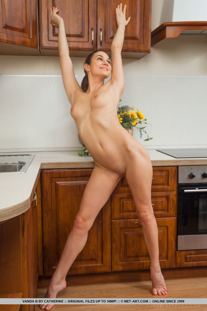 Vanda B displays her sexy, tight body and delectable pussy in the kitchen.
