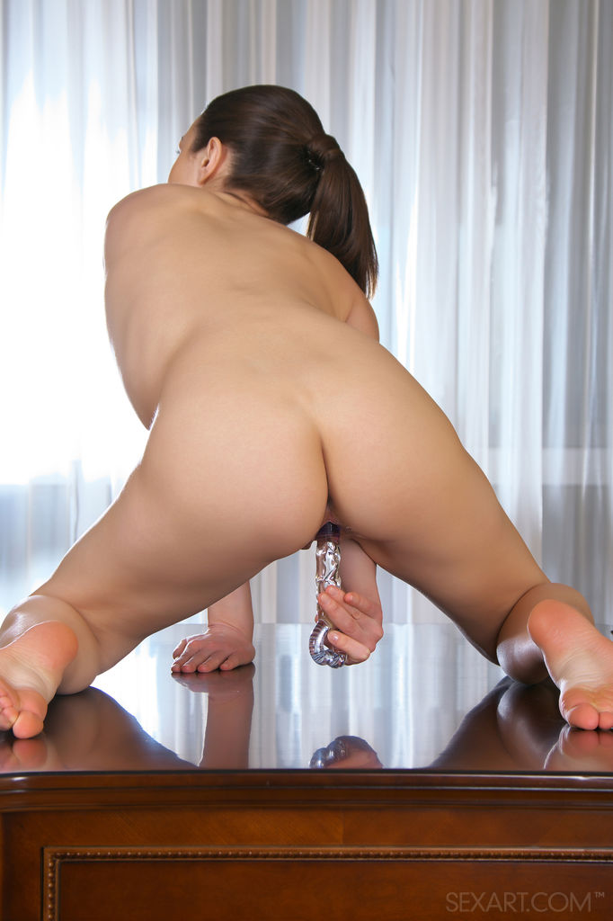 Vanda B has naughty fun with a glass dildo