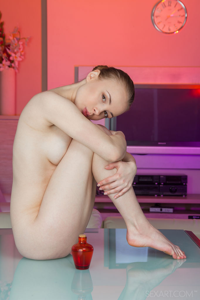 Winnie pours oils all over her naked body and starts massaging her intimate details