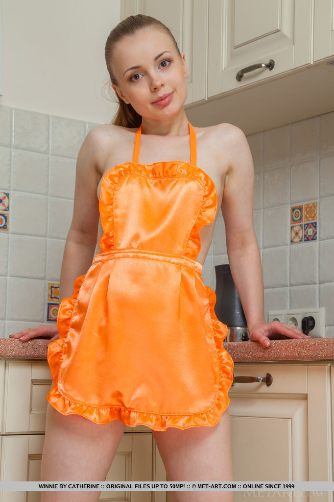 A playful Winnie wearing just an apron and ready to serve an unrestricted view of her delicious body