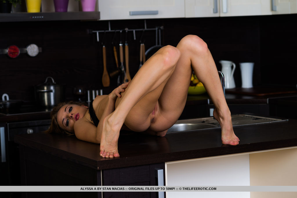 Alyssa A flaunts her naked, tight body with small perky tits and yummy pussy as she poses all over the kitchen.