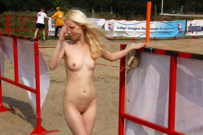Blonde posing naked at public place
