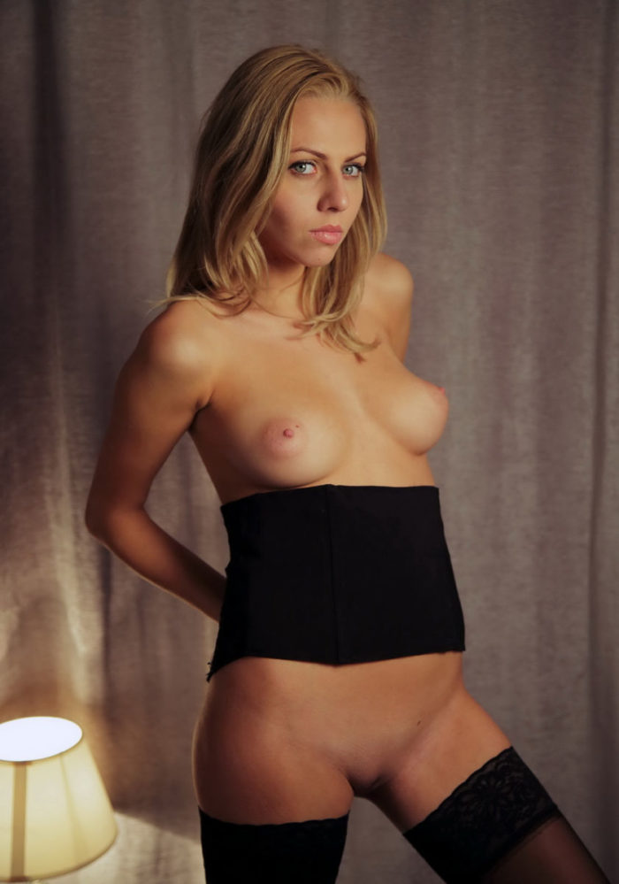Hot blonde Lija with hot natural boobs in stockings
