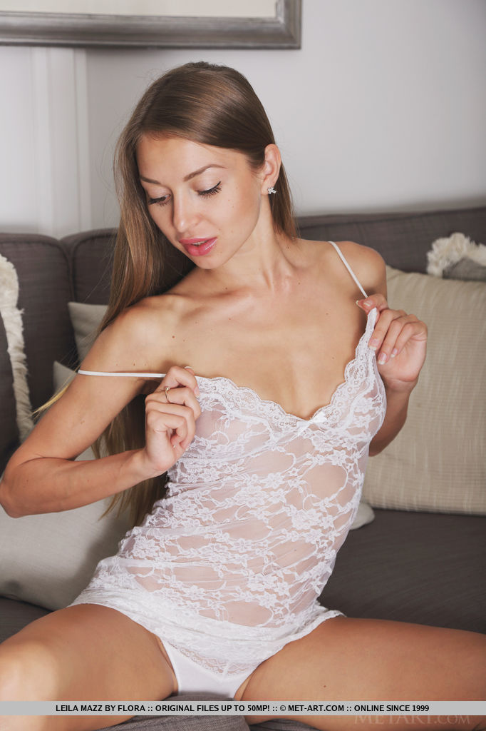 Leila Mazz in a sexy see-through lace cami and matching panty that perfectly shows off her seductive curves and lean body
