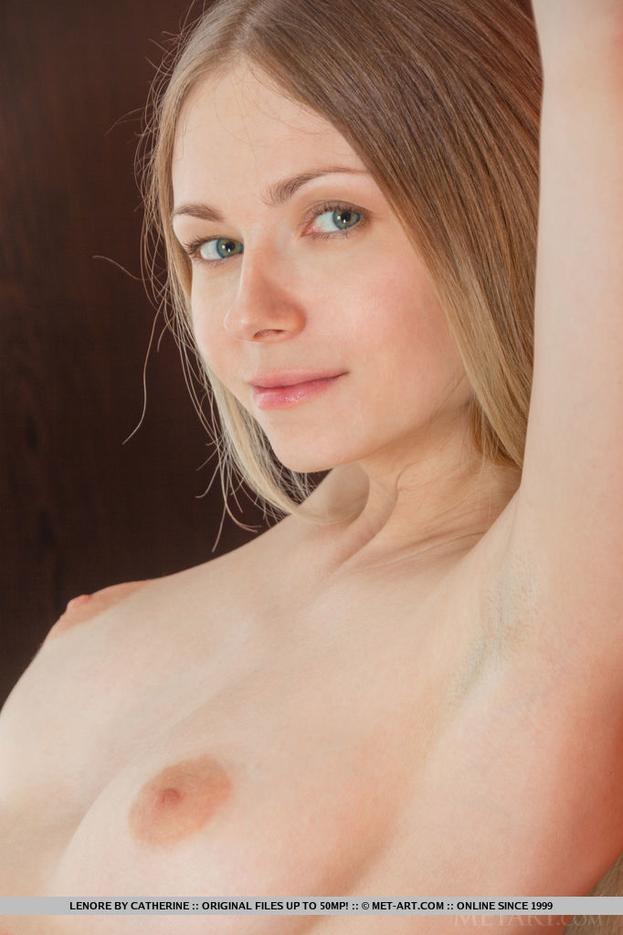 Lenore bares her slender body with pink nipples and yummy pussy as she poses in front of the camera.
