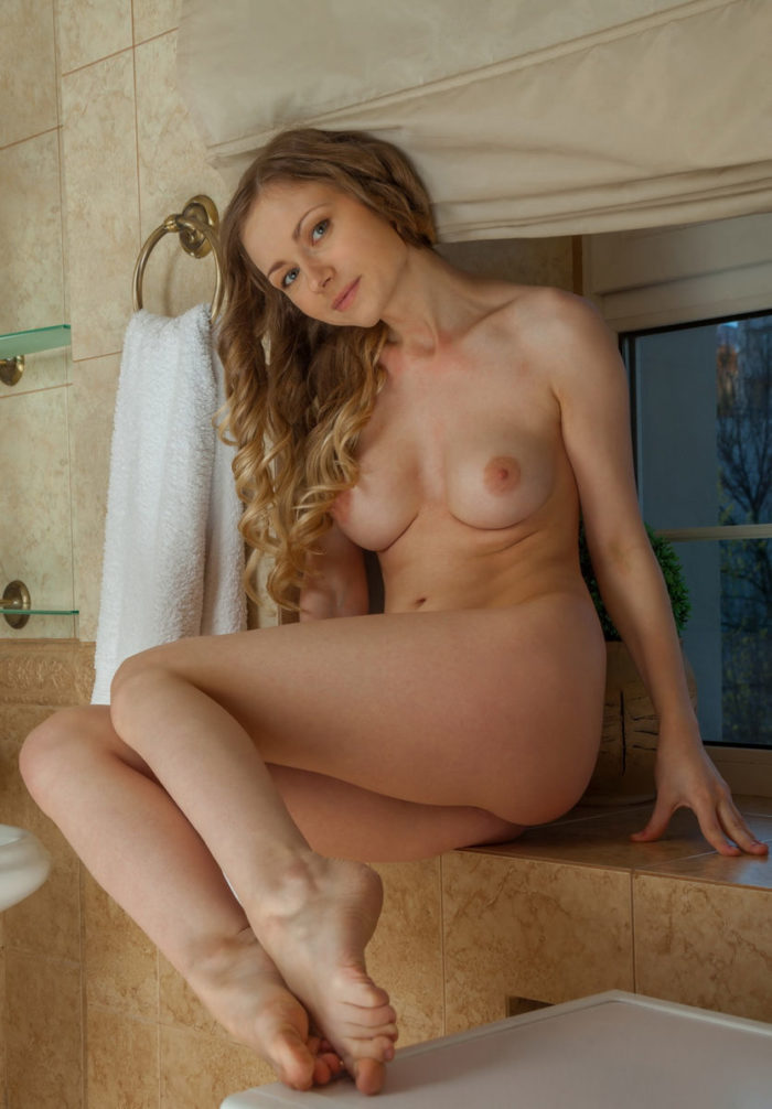 Lovely blonde Lenore with amazing body at bathroom