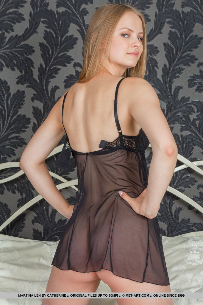 Martina Len strips her see-through night dress as she poses erotically on the bed baring her delectable assets.